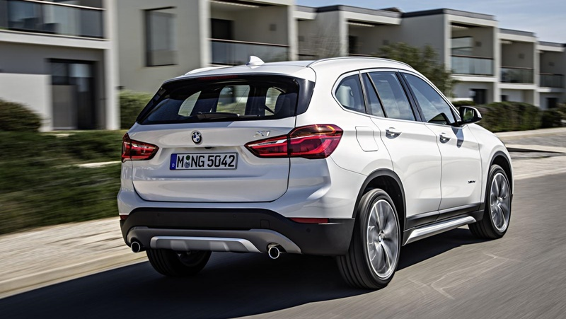 2016-BMW-X1-xDrive-20d-rear-three-quarters-right-in-motion-second-image